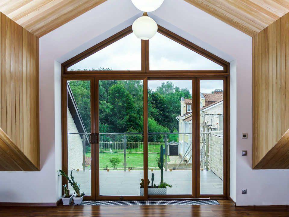 La bellezza del legno e l'efficienza dei serramenti in PVC